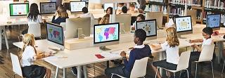 school children using computers